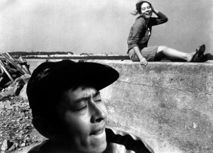 Pigs and Battleships - boy in a cap and girl on the wall
